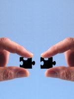 puzzle-team-hand-523233_1920